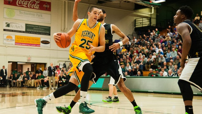Vermont's Drew Urquhart (25) drives to the hoop against Southern Vermont during Wednesday night's game at Patrick Gym.