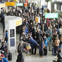Passengers stand during a major power outage at Amsterdam's Schiphol Airport.