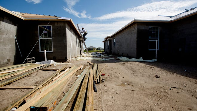 Morris Brooks, of Patnode Roofing, works on a home in the Sandoval community in Cape Coral. The Fort Myers-Cape Coral area ranks low in foreign investment for jobs.
