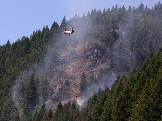 Four helicopters and 100 firefighters battled the 70-acre Niagara Fire along Highway 22 near Detroit Lake Sunday.