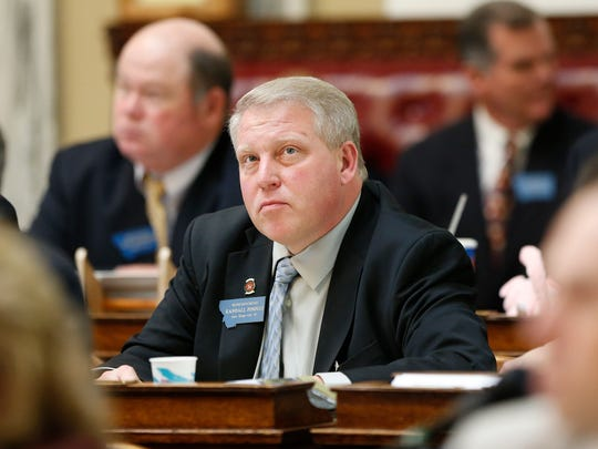 Rep. Randall Pinocci, R-Sun River, listens to a motion on the House floor during the 64th Legislature.