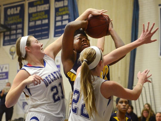 Pocomoke's Dynaisha Christian attempts to take a shot over the Decatur's Marina Jones and Lexie Van Kirk Thursday night at Stephen Decatur in Berlin.