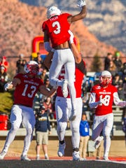 Southern Utah quarterback Patrick Tyler (3) celebrates scoring a rushing touchdown during Saturday's game against Northern Arizona, November 18, 2017, in Cedar City, Utah. Southern Utah defeated Northern Arizona 48-20 to claim the Big Sky title.