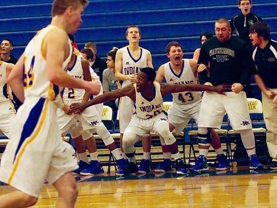 Ogo Akamelu helps Waynesboro's bench get excited during