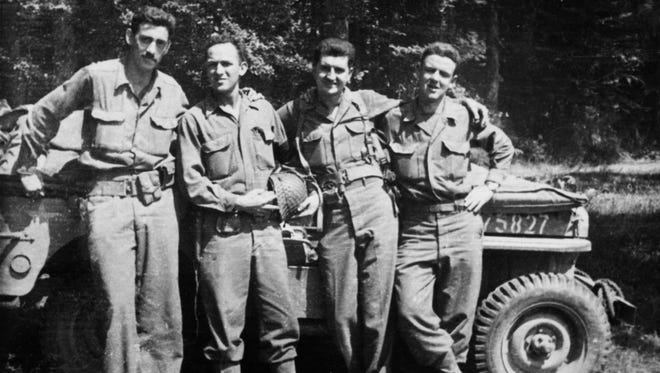 J.D. Salinger, left, after the Normandy invasion with his fellow counterintelligence officers. The group called itself 'The Four Musketeers.'