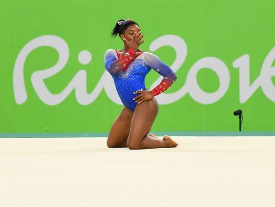 Simone Biles Wins Gold Aly Raisman Takes Silver In Floor