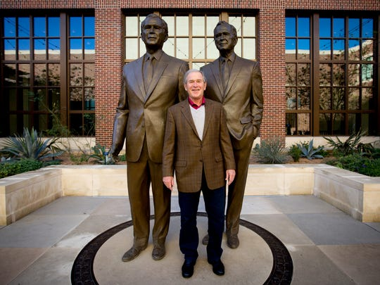 President George W. Bush with sculptures of him and