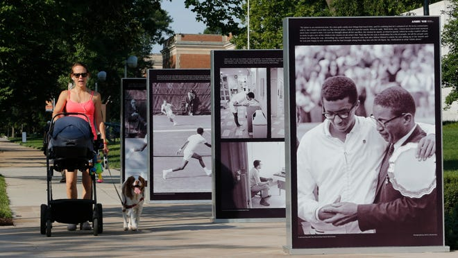 """Photographs of tennis star Arthur Ashe stand in front of the Virginia Museum of History & Culture in Richmond on Thursday as part of the exhibit """"Determined: The 400-Year Struggle for Black Equality,"""" scheduled to open Saturday."""