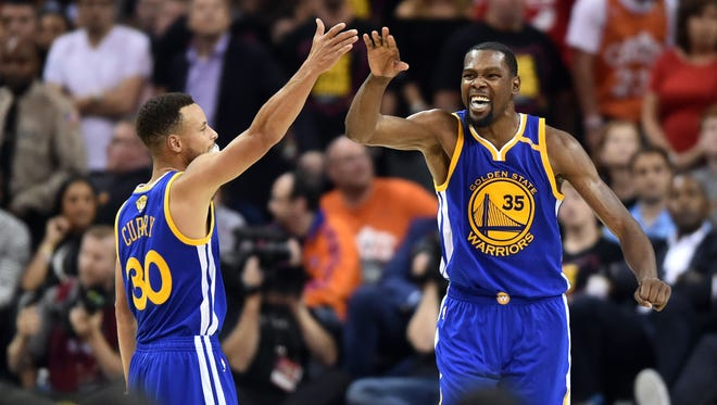Stephen Curry and Kevin Durant celebrate during the fourth quarter against the Cleveland Cavaliers in Game 3 of the 2017 NBA Finals.