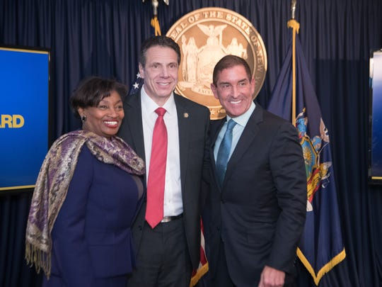 Sen. Andrea Stewart-Cousins;  Gov. Andrew Cuomo; and  Sen. Jeffrey Klein smiled for pictures April 4, 2018, after they announced that Democrats would unity in the state Senate