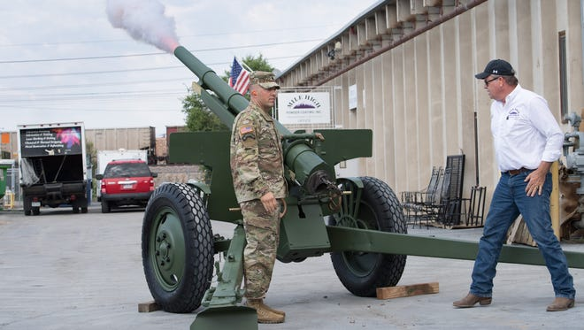 """Lt. Col. Troy Thomas, Professor of Military Science, and Duane McCall, owner of Mile High Powder Coating, test fire """"Comatose,"""" the cannon fired at Colorado State University Football games, after being restored at Mile High Powder Coating on Friday."""