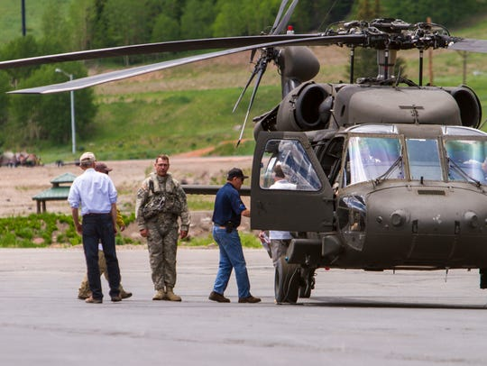 Governor Gary Herbert climbs aboard a helicopter to