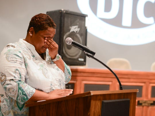 Lavundra McFadden wipes tears as she recalls her story and how her life is better now that she is drug free. McFadden graduated from the City of Jackson Drug Treatment Court at Jackson City Hall Wednesday morning with three other graduates of the program.