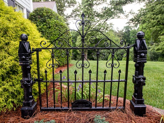 A wrought iron gate stands at the entrance to Roger and Anita Metcalf's Candler home.