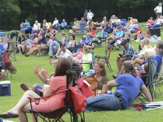 People gathered for the Down Syndrome Association of West Tennessee's beneft concert, Country Music Lends Down, Wednesday at the outdoor amphitheater at Casey Jones Village.