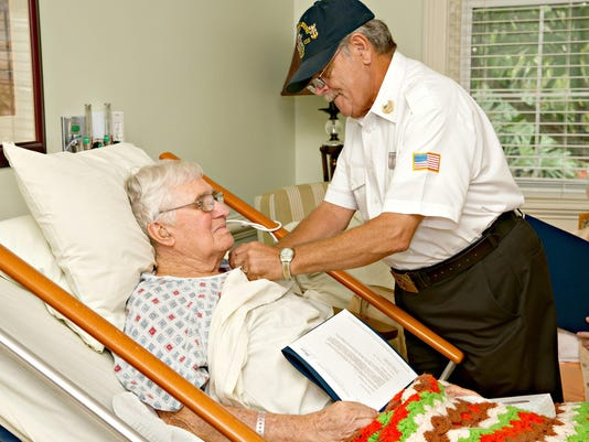 Hope Honor Guard Volunteer_Ralph Camp pins Joseph Pre-Genzer_Kate Pre-G...