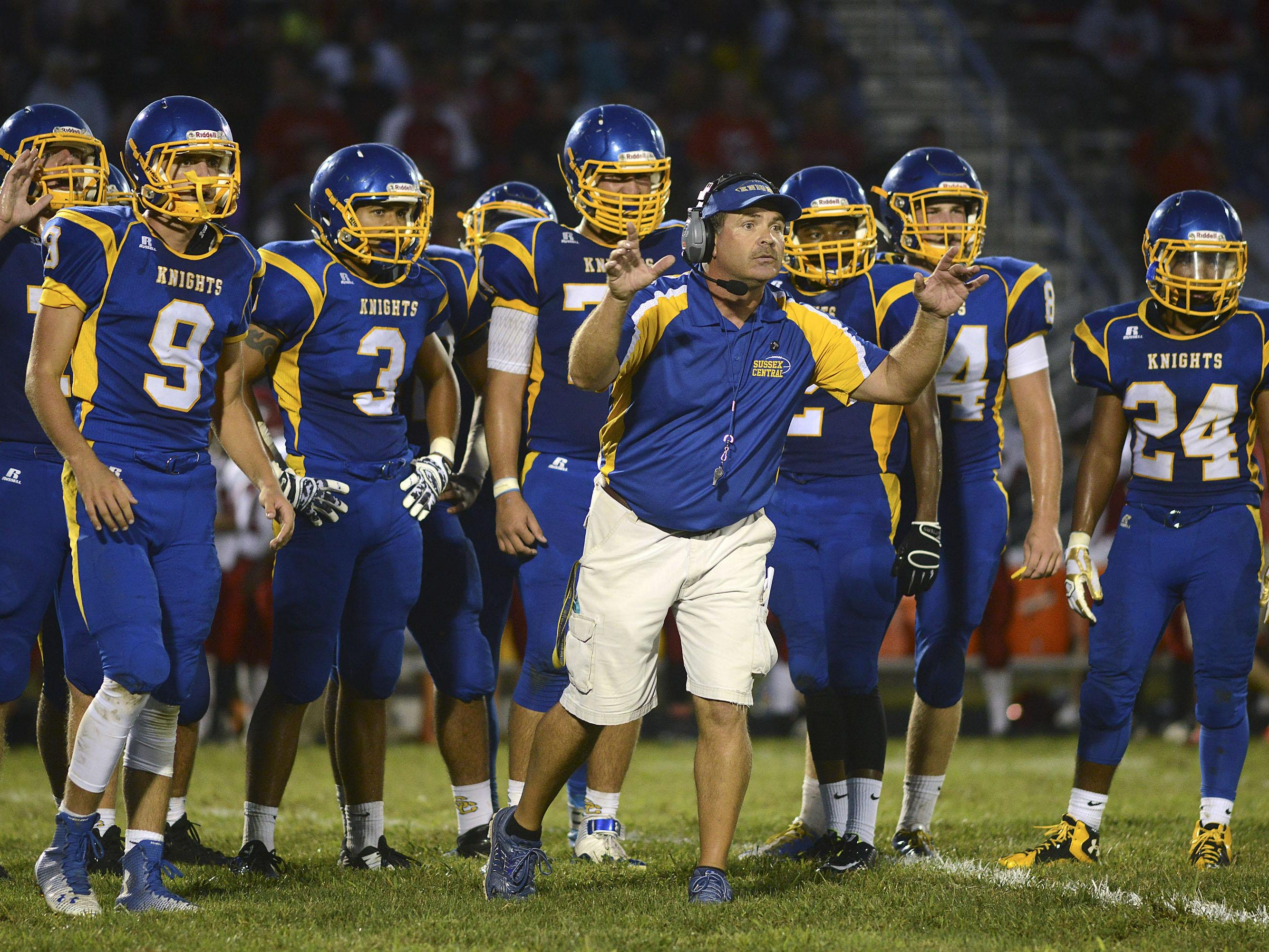 Central Sussex head coach John Wells asks fellow coaches for a play during a timeout Friday night at Central Sussex High School in Georgetown.