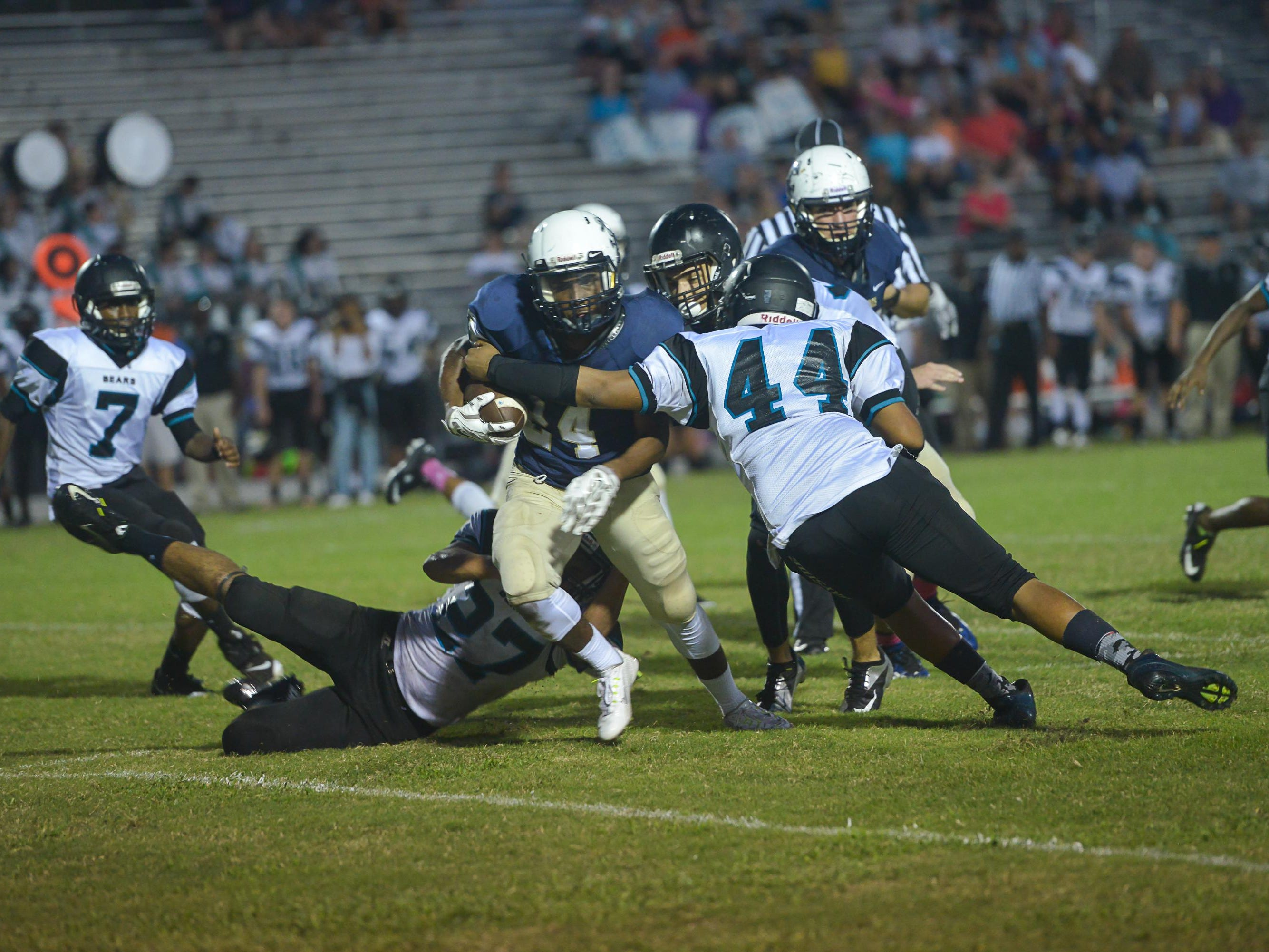 The Eau Gallie Commodores take on the Bayside Bears. (Photo by Amanda Stratford, for FLORIDA TODAY)