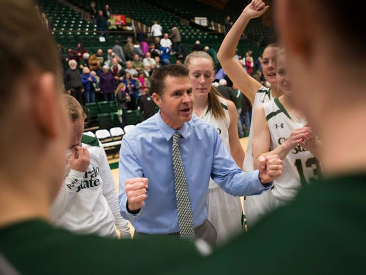 In this Saturday, Jan. 2, 2016, photo, Colorado State coach Ryun Williams confers with his players after an 68-64 win over Boise State in an NCAA college basketball game at Moby Arena in Fort Collins, Colo. Williams has led his team to a school-record 20 straight wins and counting as the Lady Rams pursue an NCAA tournament bid for the first time since 2002. (Austin Humphreys/Fort Collins Coloradoan via AP)