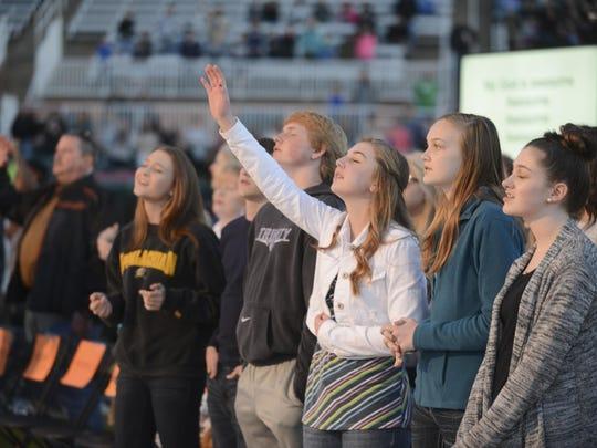 People worship during Englewood Baptist Church's 2015 worship concert at the Ballpark at Jackson.