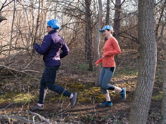 Serafina Chinappi, left, and Barbara McCloud run on