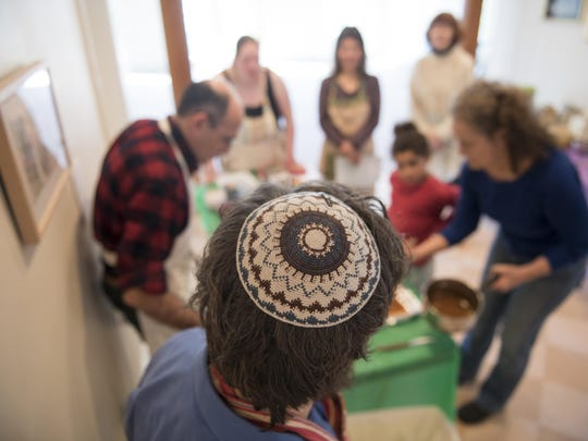 Rabbi David Edleson and Director of Education Sarit Katzew lead a Passover Desserts cooking class at the Havurah House of Addison County in Middlebury.