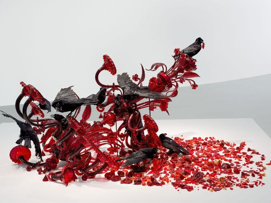 Javier Pérez's blood red Carroña (2011) at the Corning museum's new wing looks like it has fallen and smashed on the ground, with taxidermied crows pecking at the remains.