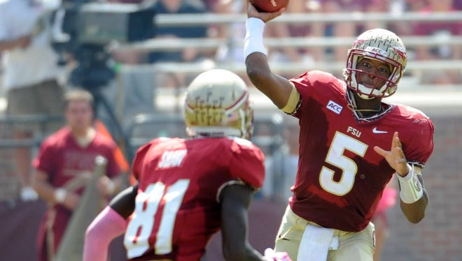 Florida State Seminoles quarterback Jameis Winston throws the ball to wide receiver Kenny Shaw against the Maryland Terrapins at Doak Campbell Stadium.