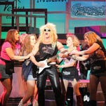 "Jamey Grisham, center, plays heartthrob rocker Stacee Jaxx in ""Rock of Ages"" at the Barn Theatre."