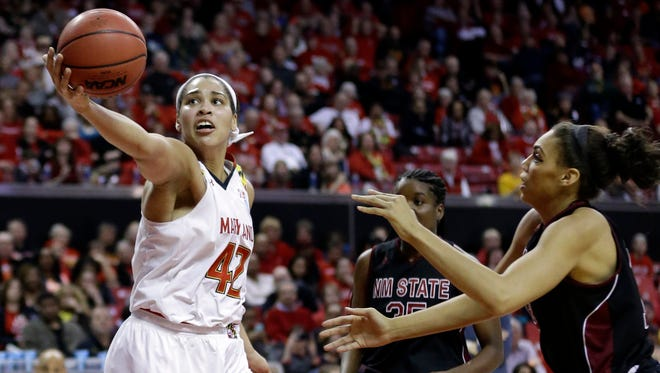 Maryland center Brionna Jones, left, reaches for a rebound against New Mexico State in Saturday's win.