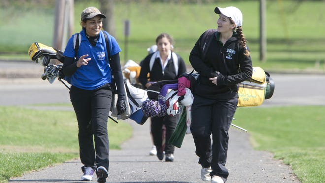 Holmdel's Haley Mander (left) and RBC's Nicole Totland (right) talk as they compete in last year's Monmouth County Tournament at Suneagles in Eatontown.