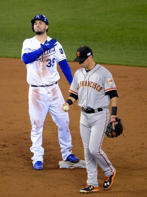 Eric Hosmer reacts after hitting a RBI double against the San Francisco Giants in the second inning during game six of the 2014 World Series at Kauffman Stadium.