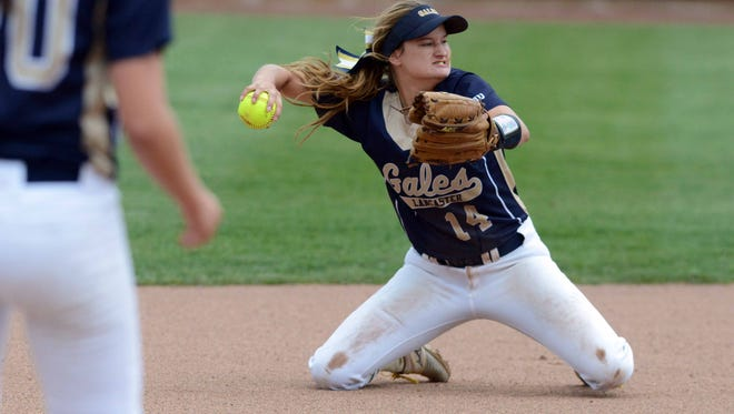 Lancaster shortstop Katie Heimberger throws to first from her knees Wednesday afternoon, May 24, 2017, during a Division I Regional Semifinal game at Ohio State University's Buckeye Field in Columbus.