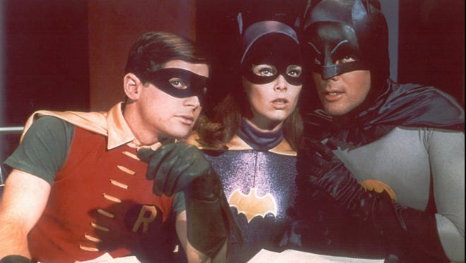 "Scene from the television show ""Batman"",with Burt Ward as Robin, Yvonne Craig as Batgirl and Adam West as Batman."