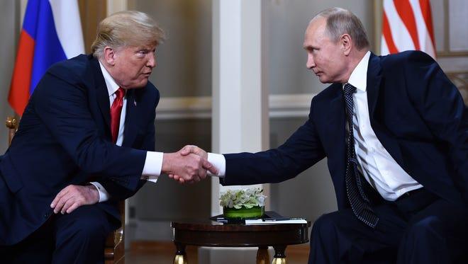 TOPSHOT - Russian President Vladimir Putin (R) and US President Donald Trump shake hands before a meeting in Helsinki, on July 16, 2018. / AFP PHOTO / Brendan SmialowskiBRENDAN SMIALOWSKI/AFP/Getty Images ORIG FILE ID: AFP_17Q12Q