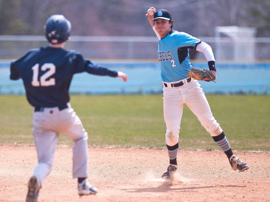 South Burlington shortstop Sam Premsagar turns a double play against Mount Mansfield during Saturday's baseball game in South Burlington.