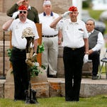 The Great Falls Marine Corp. League honor veterans with a helmet and rifle ceremony at a Memorial Day service at Highland Cemetery last year.
