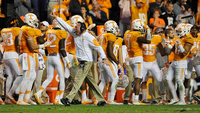 Tennessee coach Butch Jones directs his players after a score against Vanderbilt on Nov. 28, 2015.