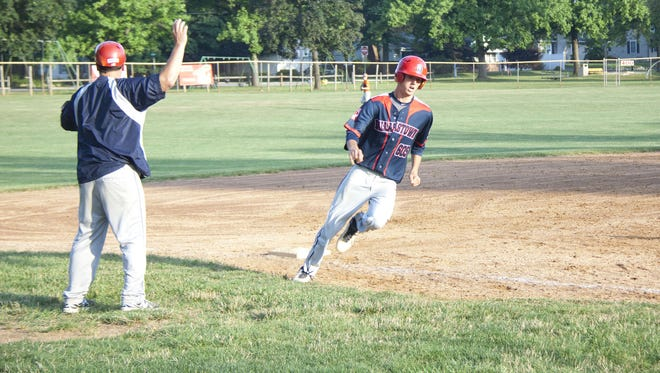 Riley Hamberger gets waved home during Friday's American Legion tournament game against Northeastern. Dallastown beat Northeastern 12-4.