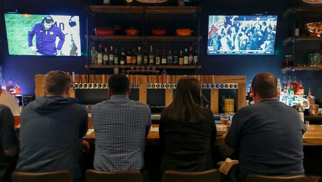 Two televisions sandwich 50 taps behind the bar at Berkley Common, which is located on 12 Mile Rd. and Griffith Ave. on Tuesday, Oct. 3, 2017 in Berkley.