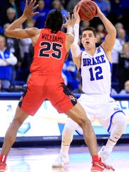Reed Timmer of Drake drives to the basket as Madison
