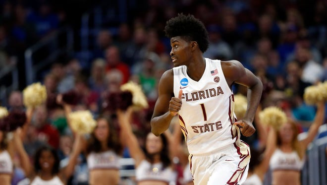 Florida State Seminoles forward Jonathan Isaac (1) reacts during the second half against the Florida Gulf Coast Eagles in the first round of the NCAA Tournament at Amway Center.