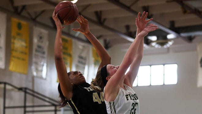 Paul VI sophomore Lauren Ebo catches the rebound over Fremd senior Erin Lenahan during the Naples Holiday Shootout at St. John Neumann Catholic High School on Wednesday, Dec. 30, 2015. Paul VI defeated William Fremd with a final score of 60-42.