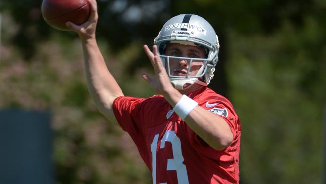Oakland Raiders quarterback Joe Southwick (13) throws a pass at rookie minicamp at the Raiders practice facility in Alameda, Calif., on May 16, 2014.
