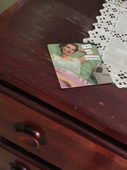 My favorite refrigerator magnet rests atop the dresser that came from my grandmother's house. As teenagers, my sister and I caused the mar in the finish by leaving our hot rollers plugged in too long.
