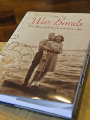 Helen and James Loer discuss their World War II experiences and their thoughts on a recent book featuring their war-era relationships Friday.