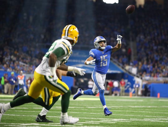 Lions receiver Golden Tate throws a two-point conversion