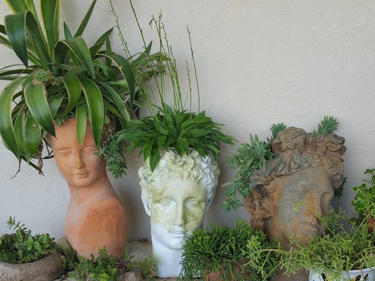 Whimsical planters offer a note of humor in Lisa Arni's garden.