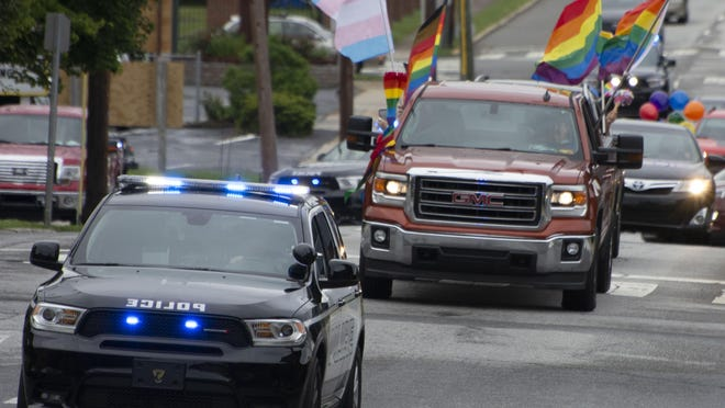 Hendersonville police help lead a car parade to celebrate Gay Pride Month on Tuesday evening in downtown Hendersonville.