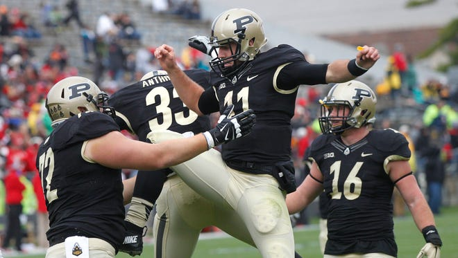 David Blough and Danny Anthrop celebrate after Anthrop's touchdown reception at 13:48 in the second quareter against Nebraska Saturday, October 31, 2015, at Ross-Ade Stadium. Anthrop's score put the Boilermakers up 14-3. Purdue beat Nebrask 55-45.